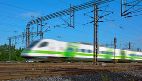 Fast train with motion blur Stock Images