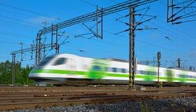 Fast train with motion blur. Fast finnish intersity train with motion blur Stock Images
