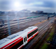 Fast train with motion blur. City in the background Royalty Free Stock Photos
