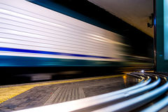 Fast Train with Motion Blur. In the train station at night Royalty Free Stock Image