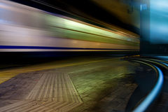 Fast Train with Motion Blur. In the train station at night Stock Photo