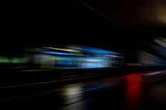 Fast Train with Motion Blur. In the train station at night Royalty Free Stock Images