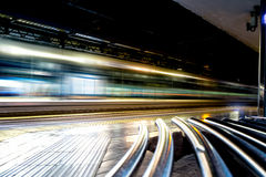 Fast Train with Motion Blur. In the train station at night Stock Images