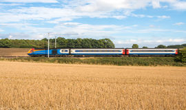 Fast train in motion. Public transport.Fast Passenger train in motion Royalty Free Stock Photo