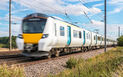 Fast train in motion. Public transport.Fast Passenger train in motion Stock Photos