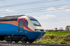 Fast train in motion. On sunny day Royalty Free Stock Photography