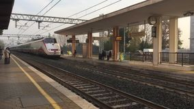Fast train. A fast train passes through a station stock video footage