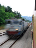 Fast train passing. At railway, photo taken from the other train Royalty Free Stock Image