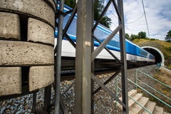 Fast train passing through a tunnel on a lovely summer day Stock Photography