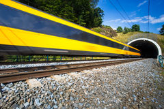 Fast train passing through a tunnel on a lovely summer day Stock Image