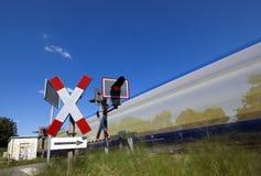 Fast train at railroad crossing Royalty Free Stock Photos