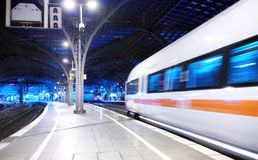 Fast train on the railway station. Composition with transport. Concept and idea at transportation item. stock image