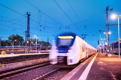 Fast train on the railway station. Composition with transport. Concept and idea at transportation item. stock images