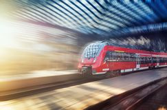 Fast train on the railway station. Composition with transport. Concept and idea at transportation item. royalty free stock photography