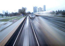 Fast train - rear view motion blur. Red Stock Photos