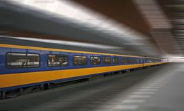 Fast train running in Holland. Fast train running in through the Bijlmer station in Amsterdam the Netherlands Royalty Free Stock Images