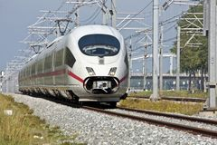 Fast train running in the Netherlands. Fast train running in the countryside of the Netherlands Royalty Free Stock Photos
