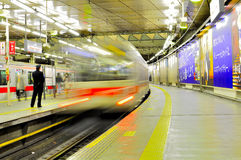 Fast train in Tokyo Station. The picture illustrates the movement of a fast train in Tokyo Train Station. A police guarded the rail to ensure neither crime nor Royalty Free Stock Photos