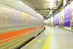Fast train in Tokyo Station. The picture illustrates the movement of a fast train in Tokyo Train Station Stock Photo