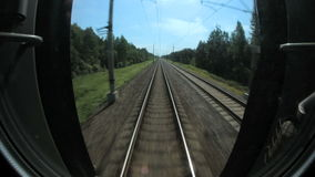 Fast train traffic on rails and sleepers, railway communications in nature stock video