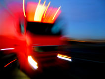 The Fast Truck. Red truck driving very fast on a road. Excellent digital masterpiece for your business design Royalty Free Stock Image
