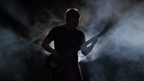 Fast tune bass guitar in the performance a musician man stock footage