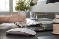 Fast typing on computer in office stock photography