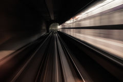 Fast underground train riding in a tunnel of the modern city Stock Images