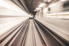 Fast underground train riding in a tunnel of the modern city Royalty Free Stock Photography