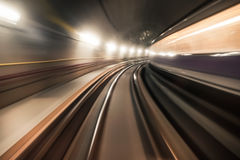 Fast underground train riding in a tunnel of the modern city Royalty Free Stock Photos