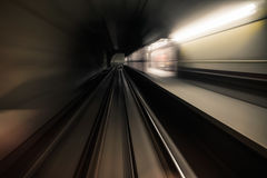 Fast underground train riding in a tunnel of the modern city Stock Photo