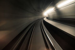 Fast underground train riding in a tunnel of the modern city Stock Photography