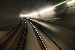 Fast underground train riding in a tunnel of the modern city. 2 Royalty Free Stock Photos