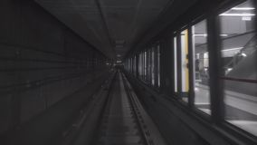 Fast underground train riding in a tunnel of the city stock video footage