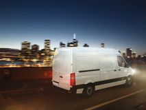Fast van on a city road delivering at night. 3D Rendering Royalty Free Stock Photos