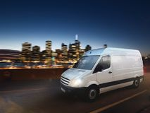 Fast van on a city road delivering at night. 3D Rendering Stock Image