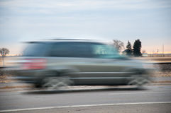 Fast vehichle rushing though the countryside Royalty Free Stock Image