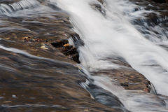 The fast water movement in a creek Stock Photo
