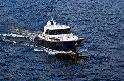 Fast white motor boat on blue water Stock Images