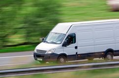 Fast white van. Very fast driving white van delivering goods Stock Photo