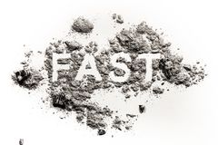 Fast word written in ash, dust or sand. As fasting for christian holiday Ash Wednesday, Good Friday, Christmas Eve, Jesus in desert time in lent period stock photos