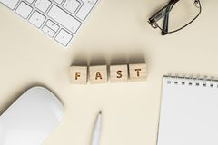 FAST Word Written FAST In Wooden Cube Conceptual White Office Stuffs Stock Photos