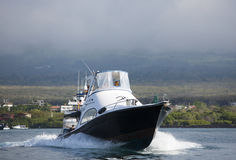 Fast yacht with tourists on board with Galapagos Islands Royalty Free Stock Photography