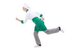 Fasta food pojęcie - szczęśliwa kobieta w szefa kuchni munduru bieg odizolowywającym Fotografia Royalty Free