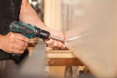 Fasten of furniture in woodworker workshop Stock Image