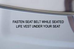 Fasten seat belt notice Royalty Free Stock Photo