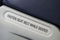 Fasten seat belt while seated Stock Photography