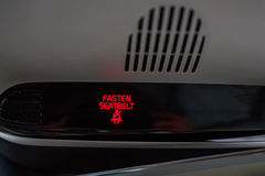 Fasten seat belt sign in car Stock Images