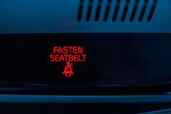 Fasten seat belt sign in car Stock Photography