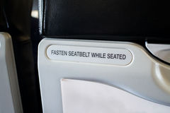 Fasten seat belt sign information on airplane Stock Photo